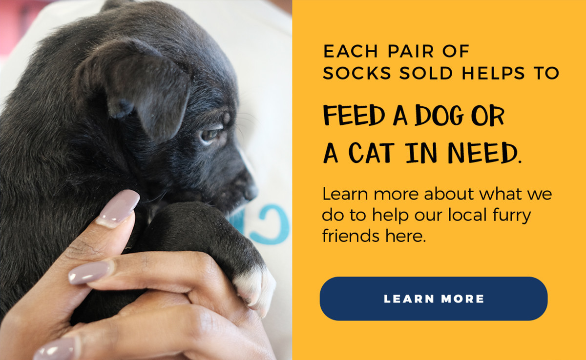 Each pair of socks sold helps to feed a dog or a cat in need. | Learn more about what we do to help our local furry friends here. | Learn More